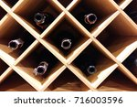 bottles of wine in wood box... | Shutterstock . vector #716003596