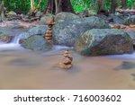 dreamy waterfall and rocks ... | Shutterstock . vector #716003602
