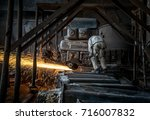 the steel worker is burnishing... | Shutterstock . vector #716007832