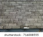old gray asphalt shingle roof | Shutterstock . vector #716008555