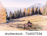 man resting on a bench with a... | Shutterstock . vector #716027536