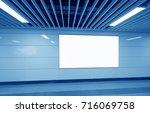 blank billboard on the wall in...   Shutterstock . vector #716069758