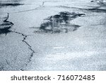 water puddles with raindrops...   Shutterstock . vector #716072485