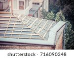 roof repair in the old house | Shutterstock . vector #716090248