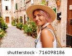 beautiful pretty woman walking... | Shutterstock . vector #716098186