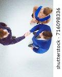 business people shaking hands   ...   Shutterstock . vector #716098336
