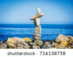 cairn on the beach of catarelli ... | Shutterstock . vector #716138758