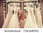 attractive young bride is... | Shutterstock . vector #716168542