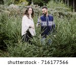 couple in a plantation checking ... | Shutterstock . vector #716177566