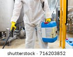 pest control worker hand... | Shutterstock . vector #716203852