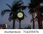lighted palm trees and... | Shutterstock . vector #716255476