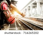 the tourist carrying a red...   Shutterstock . vector #716265202