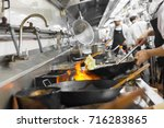 Blurred Chef Cooking Of A...