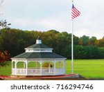 Gazebo In A Field With An...