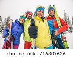 group of friends with ski on... | Shutterstock . vector #716309626