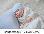 sweetly sleeping newborn baby... | Shutterstock . vector #716319292