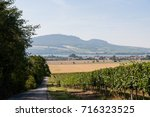 road and field on land  near... | Shutterstock . vector #716323525