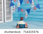 Small photo of sea theme. birthday. smash the cake for boy. biscuit ship, anchor