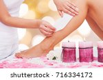 close up of a therapist waxing... | Shutterstock . vector #716334172