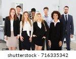 portrait of confidence multi... | Shutterstock . vector #716335342