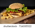 craft beef burger and french... | Shutterstock . vector #716335522