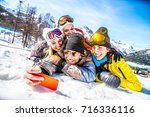 group of friends with ski on... | Shutterstock . vector #716336116