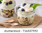 cup of breakfast healthy muesli ... | Shutterstock . vector #716337592