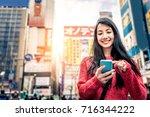 woman in tokyo | Shutterstock . vector #716344222