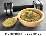wooden bowl and spoon of hemp... | Shutterstock . vector #716348488