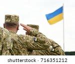 ukrainian soldiers giving... | Shutterstock . vector #716351212