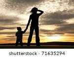 Silhouette Of Mother And Baby...
