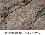 cracked wall surface of the old ... | Shutterstock . vector #716377942
