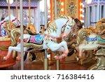 children's carousel with horses ... | Shutterstock . vector #716384416