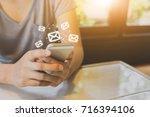 asian woman hand using mobile...   Shutterstock . vector #716394106
