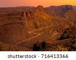 dirt road bends and turns... | Shutterstock . vector #716413366