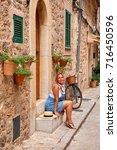 beautiful pretty woman walking... | Shutterstock . vector #716450596