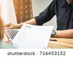 young woman submit resume to... | Shutterstock . vector #716453152