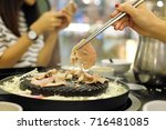 grill pork in korea style. | Shutterstock . vector #716481085