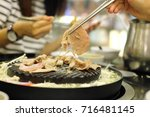 grill pork in korea style. | Shutterstock . vector #716481145