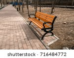 red bench in the park outdoors | Shutterstock . vector #716484772