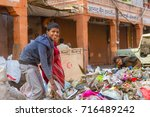Small photo of Jaipur, India, 9th January 2017 - Children rummage thru garbage in the street in Jaipur, India