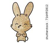 curious bunny cartoon   Shutterstock .eps vector #716492812