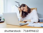 tired young office worker... | Shutterstock . vector #716494612