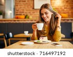 attractive smiling young lady... | Shutterstock . vector #716497192