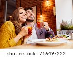 happy young couple eating... | Shutterstock . vector #716497222