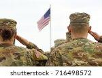 american soldiers saluting us... | Shutterstock . vector #716498572