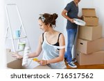 moving in to a new house. young ... | Shutterstock . vector #716517562