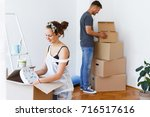 young couple in love moving in... | Shutterstock . vector #716517616