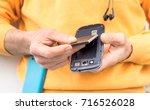 man hands inserting mobile... | Shutterstock . vector #716526028