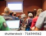speaker giving a talk at... | Shutterstock . vector #716544562